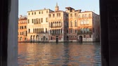 gondoliere : Building on the canal in Venice at sunset.