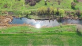 sauvage : The reflection of the sun in the river. Aerial view of the river. Spring meadows