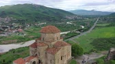 Jvari - Georgian monastery and temple. Located on top of a mountain at the confluence of Kura and Aragvi near Mtskheta. Aerial shooting Filmati Stock