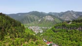 green area : Aerial view of Borjomi city, located in the mountainous province of Georgia. City in the valley among the mountains covered with forest. Borjomi georgia Stock Footage