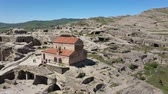 jaskinia : Uplistsikhe Cave Town. Ancient rock-hewn town that witnessed key events of Georgian history. Aerial view Wideo