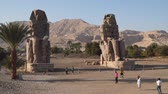 hieroglyf : Luxor, Egypt - January 16, 2020: The Colossi of Memnon are two massive stone statues of the Pharaoh Amenhotep III