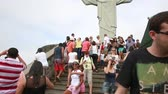 america : RIO DE JANEIRO, BRAZIL - CIRCA NOV 2014: Tourists on the Corcovado Hill in Rio de Janeiro, Brazil. The monument is the best-known Brazilian image, famous all over the world