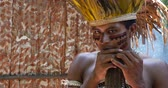 primitivo : Native Brazilian playing wooden flute at an indigenous tribe in the Amazon Vídeos