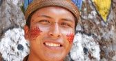 primitivo : Native Brazilian man looking to the camera at an indigenous tribe in the Amazon Vídeos