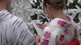 půvab : KYOTO, JAPAN - CIRCA MARCH 2017: Girls tying the Omikuji Fortune Paper in Kyoto temple, Japan Dostupné videozáznamy