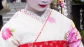 maiko : KYOTO, JAPAN - CIRCA MARCH 2017: Geisha in the ancient streets of the Gion district of Kyoto, Japan