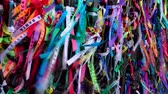 salvador : Colorful religious Brazilian wish ribbons Fita do Bonfim tied on church fence in Salvador, Brazil