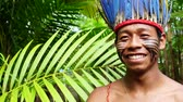 Бразилия : Indigenous man from Tupi Guarani tribe in the forest, Brazil
