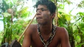 guarani : Indigenous man from Tupi Guarani tribe smoking pipes in the forest, Brazil