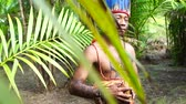 américa do sul : Indigenous man from Tupi Guarani tribe in the forest, Brazil