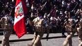 PERU, CUSCO - CIRCA AUGUST 2017: Soldiers marching in festival parade in Plaza das Armas, Cusco, Peru