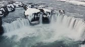 de neve : Godafoss Waterfall in Iceland in winter - an aerial view from a drone flying over the waterfall Vídeos