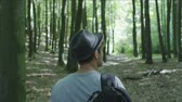 caminhões : Young Man Walking in the Woods Stock Footage