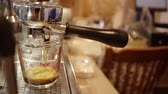 顔写真 : Barista making perfect shot coffee with coffee maker machine, business time with coffee, selective focus and free space for text, Industrial food and drink concept. 動画素材