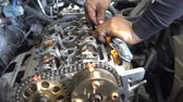 servicing : Automotive mechanic checking the auto engine. The powerful engine of a car. Motor industrial and engineering concept.