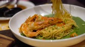 болонский : Spaghetti stir with shrimps and salted egg, basil and dry chilli. Spaghetti dish in restaurant, Selective focus and free space for text. Clean food good taste concept.
