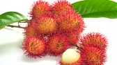 Rambutan isolated on white background. This image stacked for advertising. The tropical fruits ideas concept. Vídeos