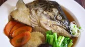 와사비 : Japanese food: Salmon head steamed with soy sauce served with Japanese cooked rice on table. Clean food concept. 무비클립