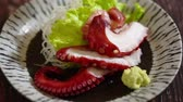 унаги : Japanese food: Octopus sashimi on table. Clean food concept. Selective focus and free space for text.
