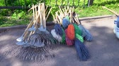метла : a man takes and throws a broom, Rakes and brooms for cleaning the backyard