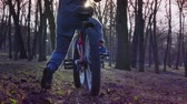 Little boy learns to ride a bicycle in the park, sundown park, slow motion Wideo