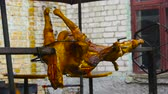 acımasız : Preparing a ram on a spit, Juicy lamb carcass spins on a spit, grilled meat