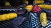 marinado : Lamb Ribs and Vegetables on a Rotating Grill, meat and corn on a barbecue, slow motion
