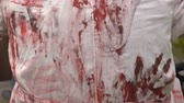 strach : Prints of bloody hands on a medical dressing gown, halloween