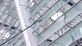 sap : Washing windows with a brush with a long handle, cleaning glass surfaces in the stadium, slow motion