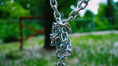 fastening : Sturdy steel chains hanging downward are connected in a single knot. Metal mount for a childrens attraction in the summer park