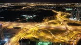 evening : time lapse from high traffic crossroads in dubai city