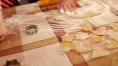 flatten : HD : Mother kneading gingerbread dough with little son
