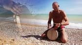 djembe : Djembe Drum Player beat rythm on the lonely beach with close up hands