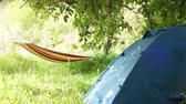 calm : Camping equipment: touristic Tent and Hammock between the trees
