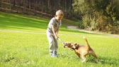little : Blonde Boy plays with his beagle Dog friend
