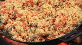 plov : Beautiful making you salivate intensively footage of a pilaf being cooked Stock Footage