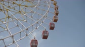 red led : Big ferris wheel rotates at amusement park ride over clean blue sky close up
