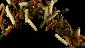 espinafre : Raw fusilli pasta bouncing and falling down on black background. Pile of multicolored macaroni flies after being exploded shot in slow motion