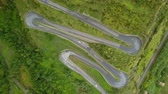 Aerial top down cars driving on serpentine road, drone above mountain road Stockvideo