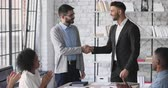 potenziale : Happy company manager handshake promote praise male intern worker in office, motivated young employee rewarded appreciated for good work results get positive feedback concept team applause at meeting