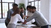trener : Successful male leader unite happy multiracial team people stack hands on table together promising support trust in partnership, help in collaboration, professional leadership concept, slow motion