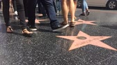 кинозвезды : LOS ANGELES - September 2016: Hollywood Walk of Fame with people walking by.