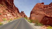 ateş : Incredibly beautiful landscape in Southern Nevada, Valley of Fire State Park USA. Smooth camera movement along the road.