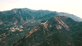parkosított : Cinema aerial panoramic video of the view of mountain formations in Malibu from a helicopter. Los Angeles, California, USA Stock mozgókép