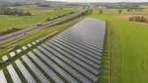 biomassa : drone aerial of a solar power plant next to the highway in agricultural landscape