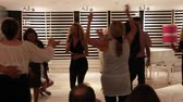 Evening dances at hotel. Active elderly people and recreation, group of happy senior men and women dancing latin american dance at party on vacation