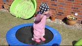 Little girl  on the trampoline