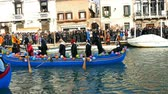 den : VENICE, ITALY - JANUARY 24, 2016: Carnival procession on the Cannaregio Canal on January 24, 2016 in Venice Italy. 4 K.
