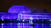 artificial lighting : LONDON, ENGLAND - NOVEMBER 29, 2017: Laser projections at Royal Kew Gardens, during Christmas time.